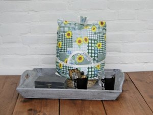 Teacosy with basket: yellow flowers on green pattern